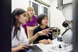 Graduate student Fariah Hayee, Professor Jen Dionne and senior research scientist Ai Leen Koh work at the electron microscope.